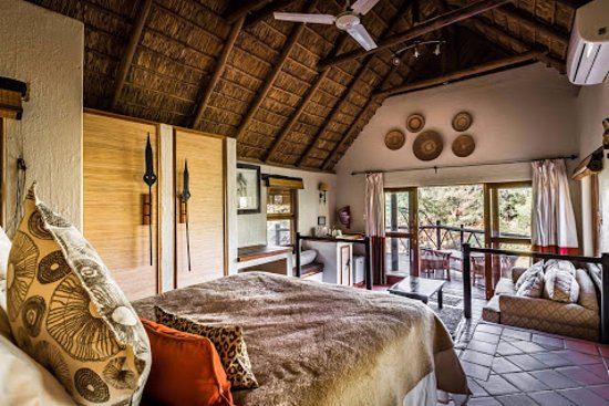 Three Cities Madikwe River Lodge: Bedroom with a view over the river (Photo by Drive South Africa, #TrekSouthAfrica)