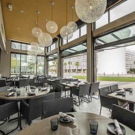 "Chroma s Solarium Dining Room faces Lake Nona Town Center s ""The"