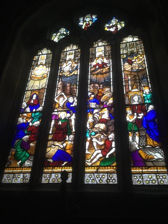 St. Neot, UK: Visited on a cloudy dark day and it was gloomy -  not showing off the fabulous windows to their