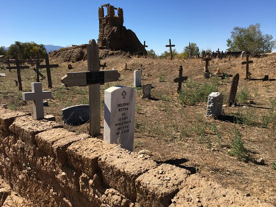 Taos Pueblo: Original church and surrounding cemetery with old and new headstones