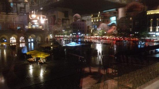 Hard Rock Cafe Kraków: View put of 1st floor window of Hard Rock cafe on to a wet, rainy Krakow square