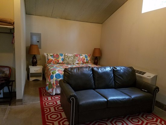 Eastport, MI: Couch and bed in Cottage