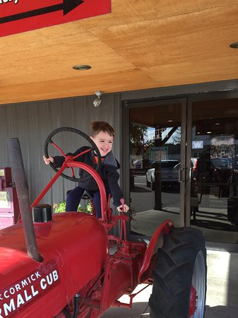 Urbana, OH: Grandson on the tractor at front door