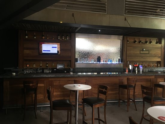 """the baron: Beautiful decor with a water """"wall"""" in the bar area."""