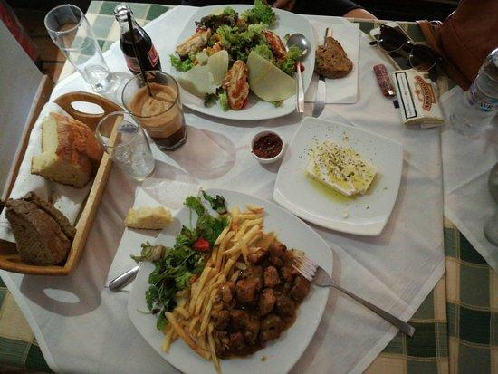 gods restaurant gods salad and pork with potatoes and feta