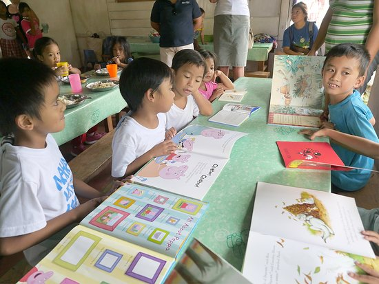 Atmosphere Resort: Guests took books for the children to read at the Soup Kitchen, these were very popular.