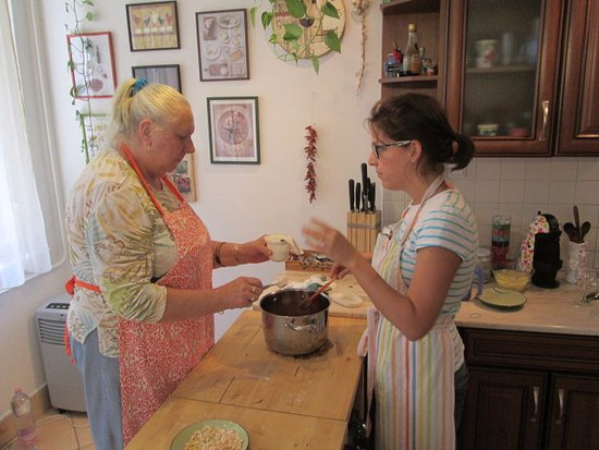 Culinary Hungary Home Cooking Class and Market Tour: Lou (my wife) and Agnes (our hostess) making Goulash soup