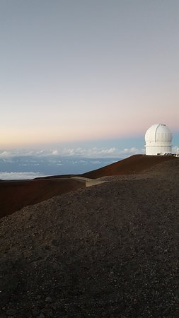 Mauna Kea Summit Adventures: Observatories on top of the mountain staring at the stars, just like us.