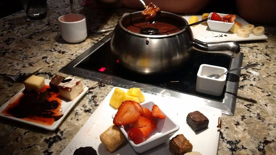 We went to the Melting Pot to celebrate or anniversary. I left feedback on the website but have not had anyone contact me yet. I would like to point out a huge safety risk. We were seated at a table whose burner did not work. They had a hot plate placed on the table.