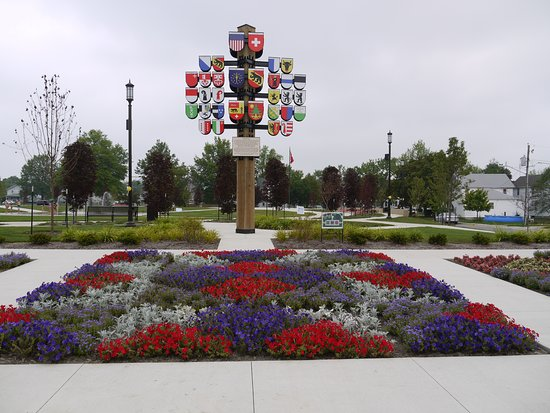 Berne, IN: flower garden and sign