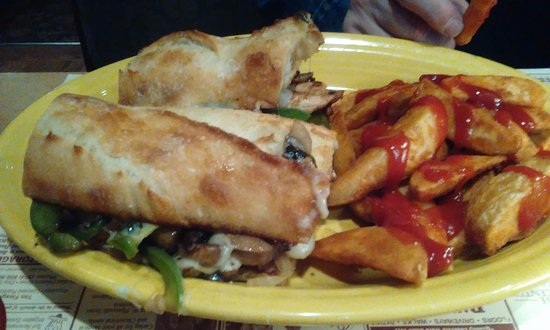 Plymouth, IN: Grilled Chicken Philly with potato wedges