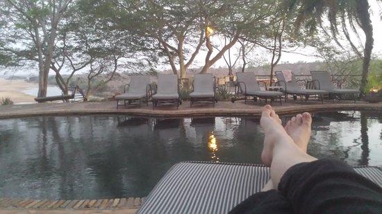 Chiredzi, Zimbabwe: Enjoying a G&T by the pool