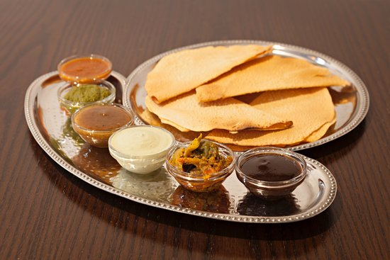 azaro dhaba indian street food our signature poppadum platter with home made chutneys