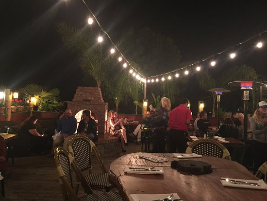 Wonderful ambiance with the outdoor fire & string lights Food great