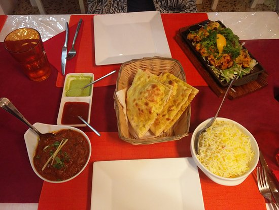 Lamb vindaloo, saffron rice, garlic naan, chicken tanduri with lemon. All delicious.