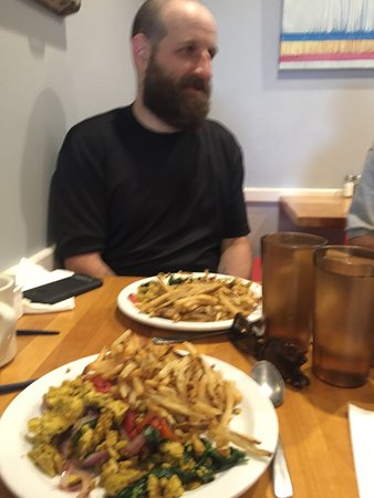 Ants Pants Cafe: My tofu scramble and fries with friend in background