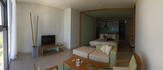 room 1703, living room next to the glass wall, kitchen at the back.