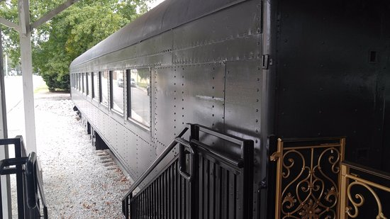 Aiken Visitors Center and Train Museum: railcar parked outside the museum