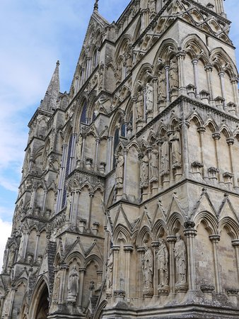 The beautiful and grand gothic facade of Salisbury Cathedral.