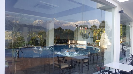 mountain reflection on summit restaurant glass - picture of