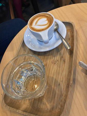 Olympia Coffee Roasting Co.: Macchiato, cappuccino and the interior