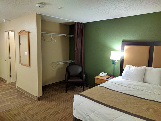 "Extended Stay America - Austin - Downtown - Town Lake: Studio room with one queen bed, the bed and the ""wardrobe""."