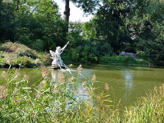 Flora: A pretty pond with sculpture.