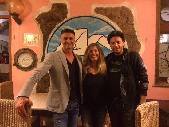 The owner of La Grotta (in the light jacket) made sure that our dining experience was superb!