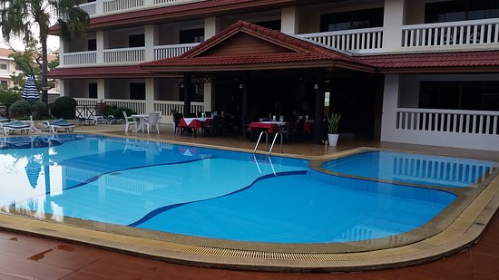 The Residence Garden: Front of hotel 1 of 2 pools