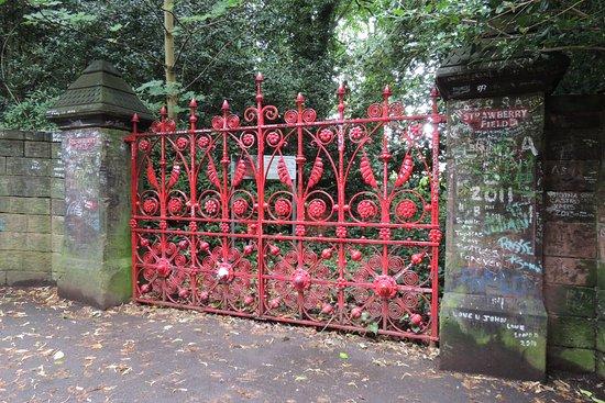 Mendips - John Lennon Home: Strawberry Field's recast gate plus graffiti.