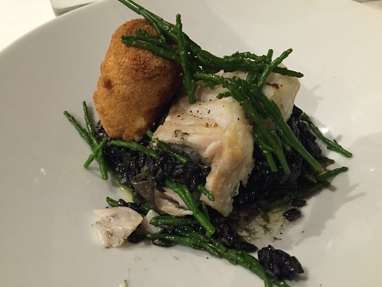 Winford, UK: Cod and squid ink risotto with king prawn croquette. Delicious