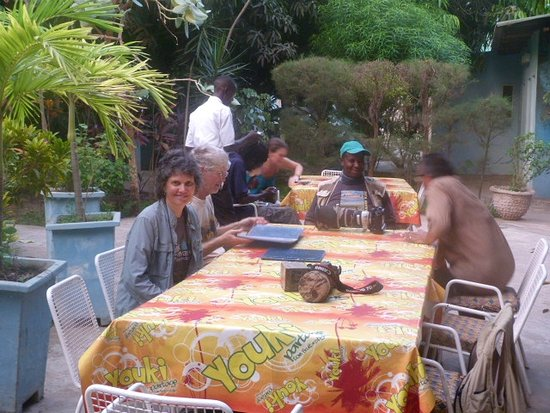 Sukuta, Gambia: Dine on the patio or inside near the bar and TV