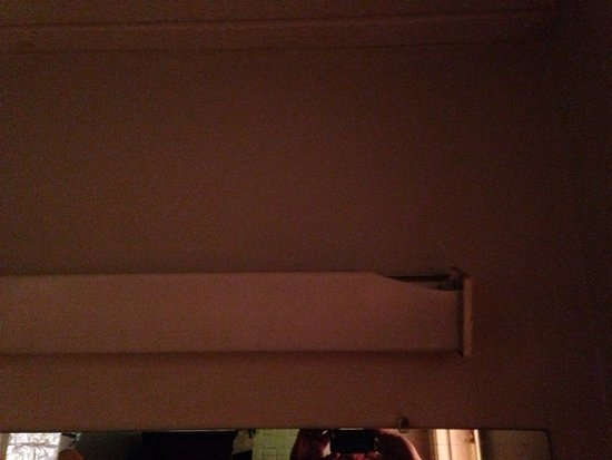 Daleville, AL: Broken/inoperative light fixture over vanity
