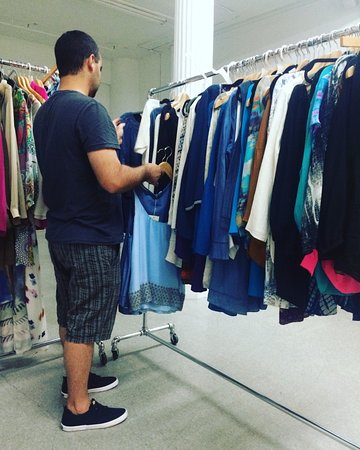 Shop With Rox: Helping his wife choose from the fab designer pieces.