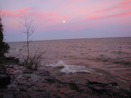 Sturgeon Bay, WI: The moon's glow over the limestone apron at the lake's edge