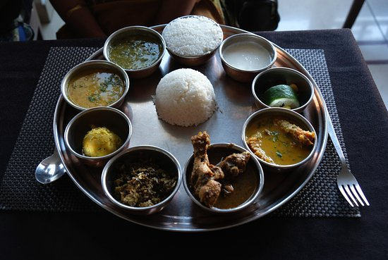 This thali includes assamese style fish curry chicken for Assamese cuisine fish
