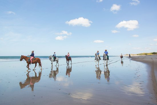Tola, Nicaragua: Guests enjoying an adventure on horseback down Playa Santana