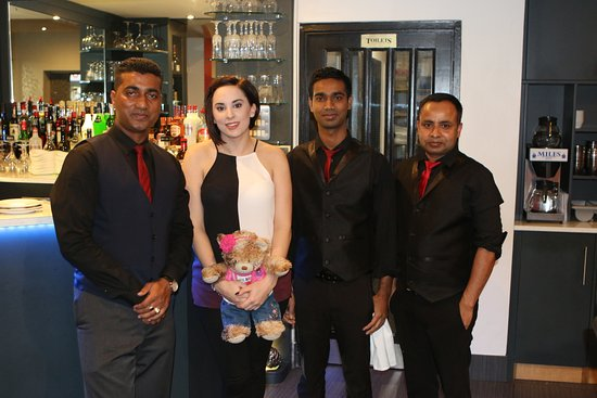 Williton, UK: My daughter with some of the staff from the Bengal Spice