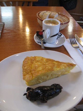 Pepe Pica: A chunky slice of tortilla with morcilla and a cafe cortado.