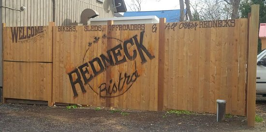 Redneck Bistro: fence in the parking lot across from the micro brewery