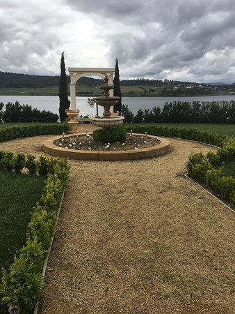 Austins Ferry, Australia: Front, back and garden area of this beautiful B&B. The picture of the bedroom is the Parisian su