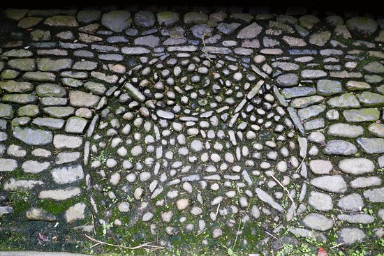 Yongding Earth Building: Cobblestone arranged in a Chinese ancient coin design