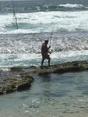 The Fortress: A local fisherman on the beach at the back of the hotel
