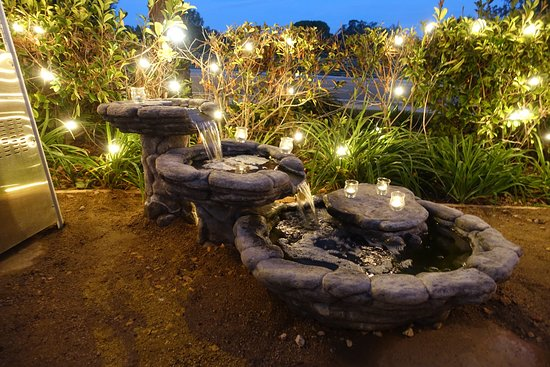 Arohau0027s Outdoor Patio Is Decorated With Serene Water Features On The Front,  Side, And