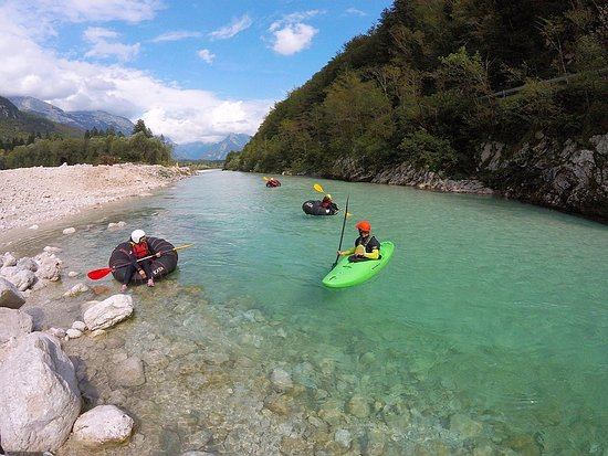 Bovec, Slovenia: Family enjoying relaxing river tubing on Soča in the heart of Julian Alps.