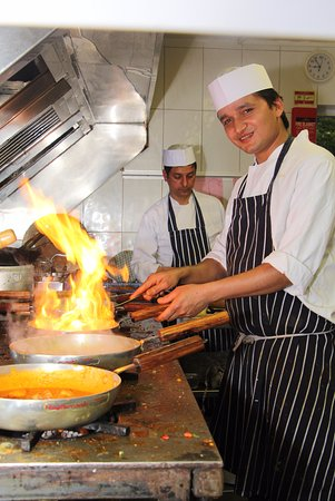 Clay Cross, UK: chef enjoying whilst blowing spices on saturday night busy busy
