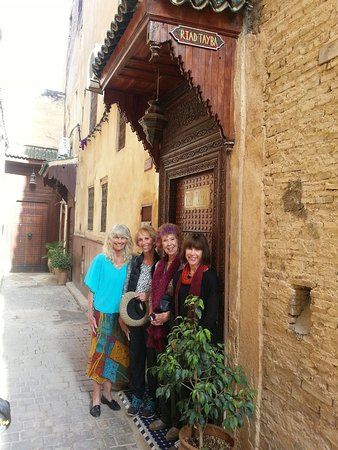 Happy travelers at the entry to Riad Tayba, in the medina (old walled city).