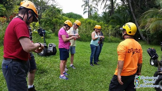 Segway Off Road at Botanical World Adventures: Dylan (orange shirt) shared some local fruit with us - starfruit and a custard flavored one also