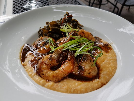 Bayona: New Orleans BBQ Shrimp with pimento cheese grits & smothered greens