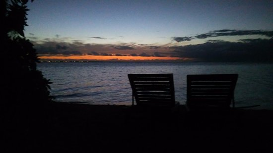 Fafa Island, Tonga: Sunset from deck chairs at beach in front of our Fale